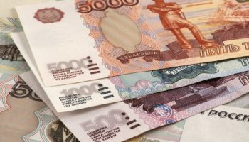 sanctions hit russian economy as ruble plummets